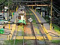 Outbound train at Waban station from Beacon Street, September 2015.JPG