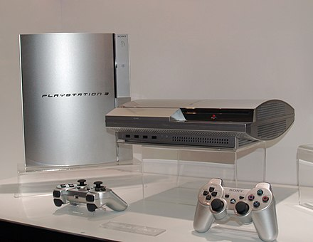 Silver PlayStation 3 consoles on show in 2006 PS3s and controllers at E3 2006.jpg