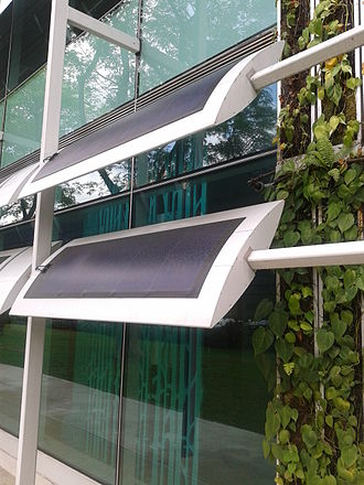 Photovoltaic mounting system - PV panels as external shading device in zero-energy building, Singapore