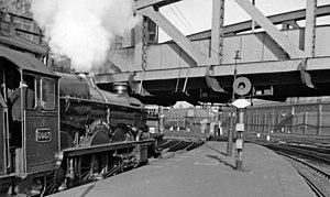 Bishop's Bridge - A GWR 4073 Class locomotive waits waits to depart, adjacent to Brunel's cast-iron bridge (April 1962)