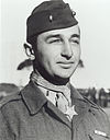 man in Marine uniform with cap, medal around neck