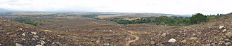 Lopé National Park - Panorama of the northern savannah dominated part Lopé National Park, shortly after the annual grass burning