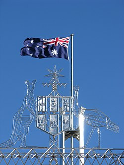 Parliament House Canberra - flag and coat of arms (2767640220).jpg