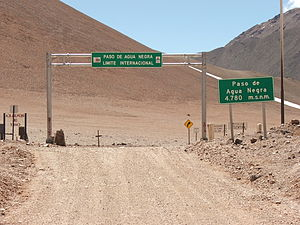 Agua Negra Pass - Signs marking the border between Argentina and Chile at the top of Paso de Agua Negra.