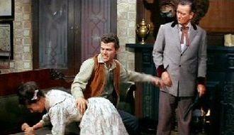 McLintock! - John Wayne watches as Patrick Wayne spanks Stefanie Powers.