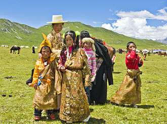 Tibet - Tibetan family in Kham attending a horse festival
