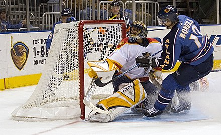 Peter Bondra of the Atlanta Thrashers shoots the puck and scores against Roberto Luongo of the Florida Panthers during the 2005-06 NHL season Peter Bondra scoring.jpg