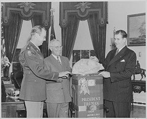 National Thanksgiving Turkey Presentation - Image: Photograph of Sen. Olin Johnston of South Carolina presenting President Truman with a turkey from Wilton E. Hall of... NARA 199536
