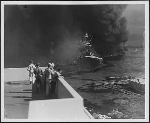 Photograph of the USS California sinking into the mud of Pearl Harbor - NARA - 306538