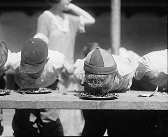 Competitive eating - Pie-eating contest at the Jefferson School in Washington, DC, August 2, 1923.