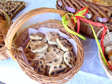 basket filled with round, flat pieces of bread with some browning and charring on the surface