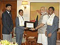 Poorna Malavath and Anand Kumar, teenaged mountaineers who recently scaled Mt. Everest, calling on the Prime Minister, Shri Narendra Modi, in New Delhi on June 06, 2014. Their coach, Shri Shekhar Babu is also seen.jpg