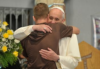 Pope Francis hugs a man in his visit to a rehab hospital.jpg