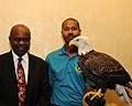 Posing for picture with Bald Eagle. (10595316295).jpg