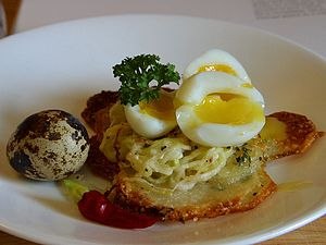 Quail eggs - Potato galettes, served with quail eggs.