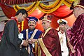 Pranab Mukherjee presenting the medal to a student, at the 13th convocation of Visvesvaraya National Institute of Technology, at Nagpur, in Maharashtra. The Governor of Maharashtra, Shri C. Vidyasagar Rao is also seen.jpg