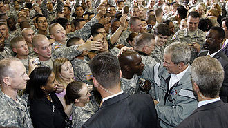 Secret Service agents to guard President George W. Bush in 2008. President George W. Bush greets troops guarded by Secret Service.jpg