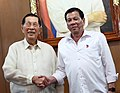 President Rodrigo Roa Duterte shakes hands with Former Senator Juan Ponce Enrile.jpg