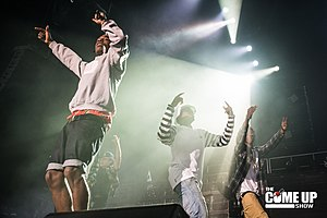Pro Era Members Nyck Caution, Kirk Knight, and Joey Bada$$ alongside rapper A$AP Rocky at the Under the Influence Tour show in Toronto Canada (August 10, 2013).jpg
