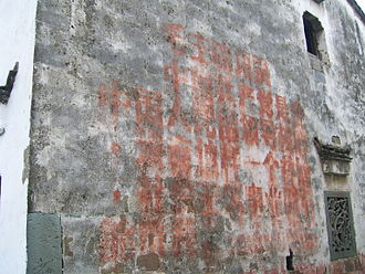 Quotations from Chairman Mao Tse-tung - Faint words from Chairman Mao's Little Red Book, painted during the Cultural Revolution, still appear on walls in some Chinese villages, photo 2005.