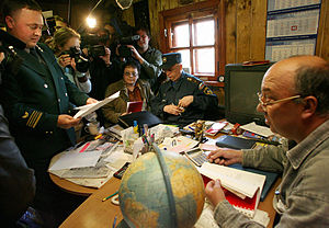 RIAN archive 128341 Rosprirodnadzor, police and prosecution experts inspect the Tver Region.jpg