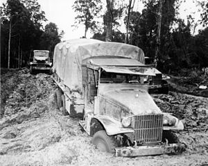 Red Ball Express - A Red Ball Express truck gets stuck in the mud - 1944