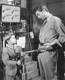 Black and white promotional image of Tommy Rettig and Robert Mitchum in the 1954 film River of No Return