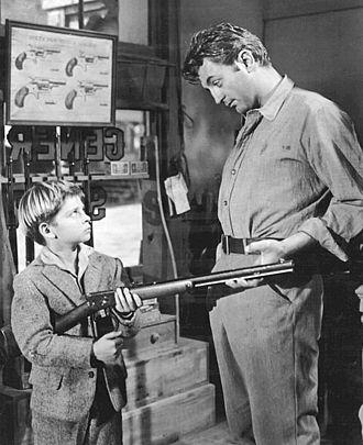 Tommy Rettig - Rettig with Robert Mitchum in River of No Return (1954)