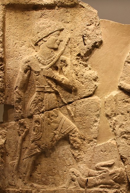 A low-relief dating to circa 2000 BC, from the kingdom of Simurrum, modern Iraq Rock Relief of Iddin-Sin, King of Simurrum.jpg