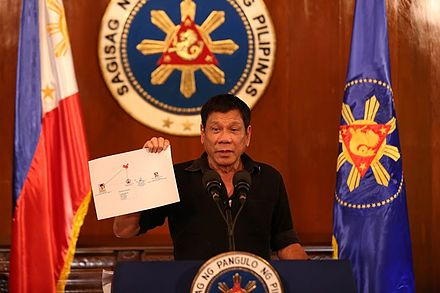 Duterte shows a diagram of drug syndicates at a press conference on July 7, 2016. Rodrigo Duterte showing diagram of drug trade network 1 7.7.16.jpg