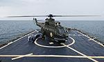 Romanian Navy IAR-330 medium helicopter conducts flight operations aboard USS Ross (1).jpg