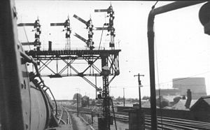 Gantry (road sign) - A gantry of British semaphore signals seen from the cab of a steam locomotive