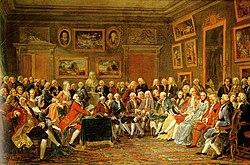 Διανοούμενοι συγκεντρωμένοι γύρω από την προτομή του Βολταίρου στο σαλόνι της Madame Geoffrin στα 1755 (Anicet-Charles-Gabriel Lemonnier, 1812, Château du Malmaison, Rueil)