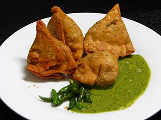 Samosa - Samosas with chutney and green chilies in West Bengal, India.