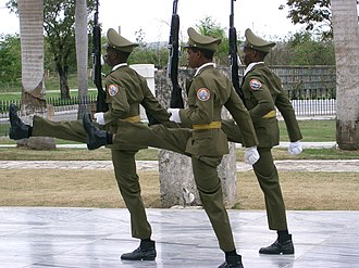 Guard mounting - Members of the Ceremonial Unit of the Cuban Revolutionary Armed Forces on their way to relieve guards at the José Martí Memorial.