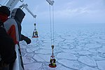 Scientists work putting trackers on the ice in the Marginal Ice Zone of Antarctica.jpg