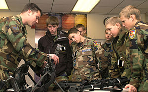 Colorado Wing Civil Air Patrol - Senior Airman Paul Kelly explains weapon handling and safety to members of the Colorado Springs Cadet Squadron.