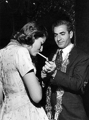 Soraya Esfandiary-Bakhtiari - Shah lighting cigarette for his wife Soraya