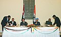 Sharad Pawar and the Jordanian Minister for Trade and Industry, Mr. Salem Khazaaleh signing a MoU on cooperation in the field of agriculture in the presence of the Prime Minister, Dr. Manmohan Singh and the King of Jordan.jpg