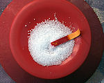 Sodium bisulfate, as a white powder, turns indicator paper red.