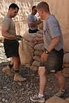 Soldiers fill sandbags for exercise DVIDS300656.jpg