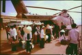 South Vietnamese villagers board an Air Force CH-3C helicopter for evacuation to another village as U.S. forces... - NARA - 542336.tif