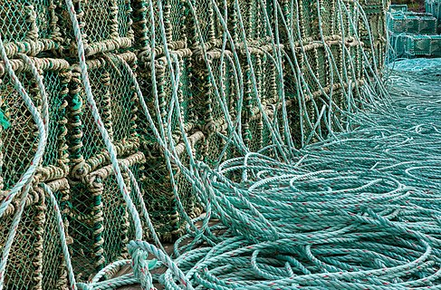 Stacks of lobster traps and ropes in Norra Grundsund
