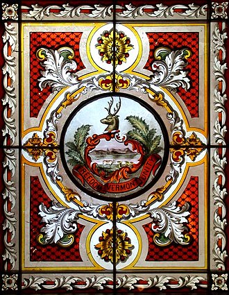 Vermont State House - The state coat-of-arms is illustrated in one of two stained glass skylights In the Cedar Creek Room, a reception room in the west wing.