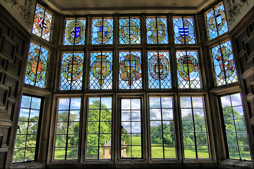 The window of the Great Chamber depicts the arms of families connected to the Phelips by marriage Stained glass window, overlooking gardens of Montacute House (4675709559).jpg