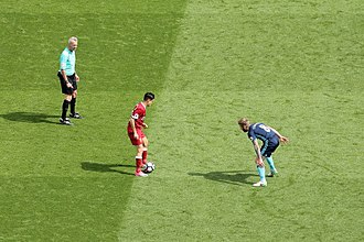 Adam Clayton (footballer) - Clayton (right) watches Liverpool's Philippe Coutinho on the final day of the 2016–17 Premier League season.