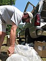 Steve Fraley moving bags of spotfin chubs to the banks of the Cheoah River (4773892675).jpg