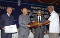 Sushil Kumar Shinde presenting the National Award for Meritorious Performance in various facets of power sector to the General Manager NTPC power plant Simhadri, Andhra Pradesh, Shri Y.J.Rao, in New Delhi on March 20, 2008.jpg
