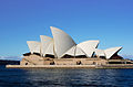 The Sydney Opera House appears to float on the harbour. It has numerous roof-sections which are shaped like huge shining white sails