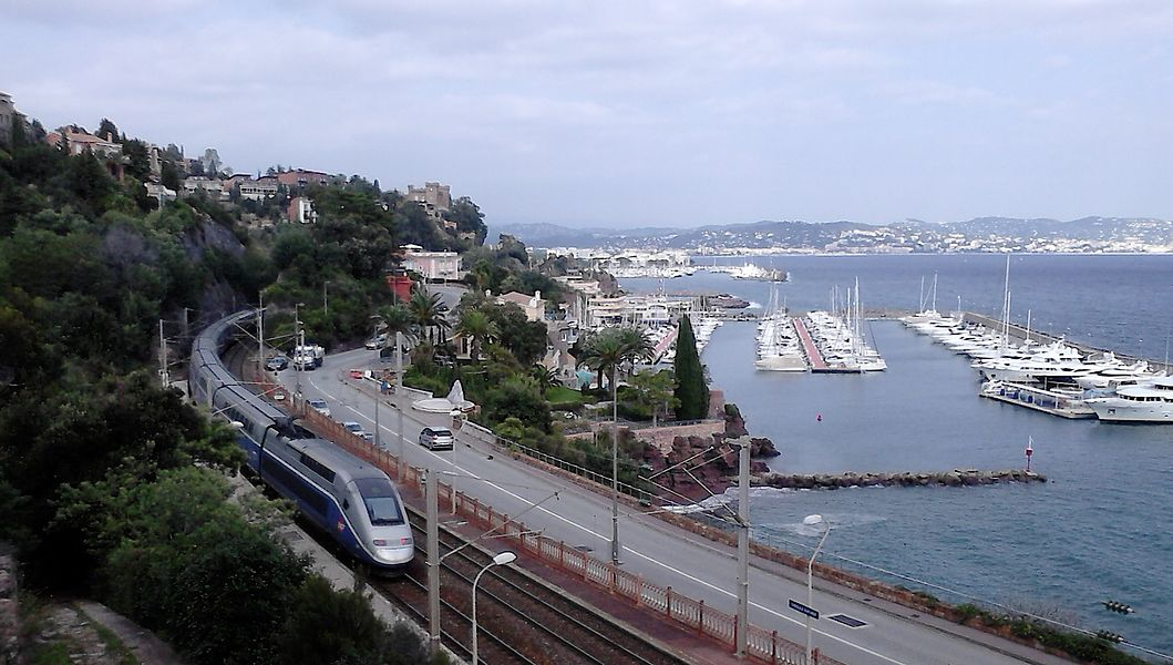 TGV Duplex to Nice, crossing Théoule-sur-Mer station in Marseille–Ventimiglia railway , France.